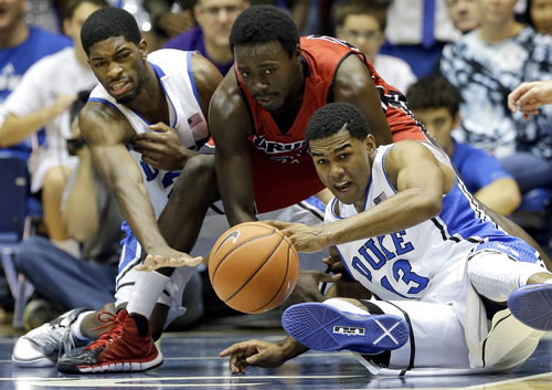 Duke's Amile Jefferson, left, and Matt Jones (13) struggle for a loose ball with Drury's Cameron Adams during the second half of an exhibition NCAA college basketball game in Durham, N.C., Saturday, Nov. 2, 2013. Duke won 81-65. (AP Photo/Gerry Broome)