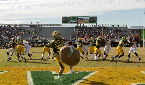 Norfolk State punter Dalton Fraser (30) who was standing in the end zone to punt, watches a high snap from center sail out of the end zone for a safety late in the second quarter  of an NCAA college football game against Florida A&M Saturday, Nov. 2, 2013 at Dick Price Stadium in Norfolk, Va. (AP Photo/The Virginian-Pilot, Bill Tiernan)  MAGS OUT