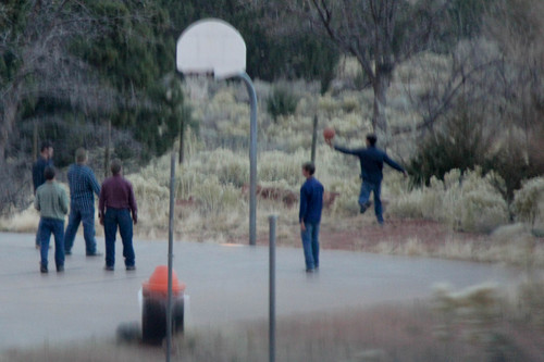 Boys play basketball in one of a series of photographs found on a memory card and alleged to have come from an FLDS church security team.