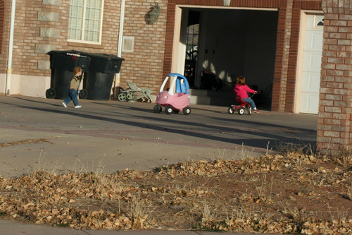 Young children in front of a suburban home in one of a series of photographs found on a memory card and alleged to have come from an FLDS church security team.