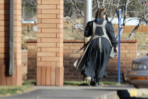A woman leaves a place of business in one of a series of photographs found on a memory card and alleged to have come from an FLDS church security team.