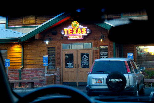 The front entrance to the St. George location of Texas Roadhouse, where two people were photographed meeting in a series of photographs found on a memory card and alleged to have come from an FLDS church security team.