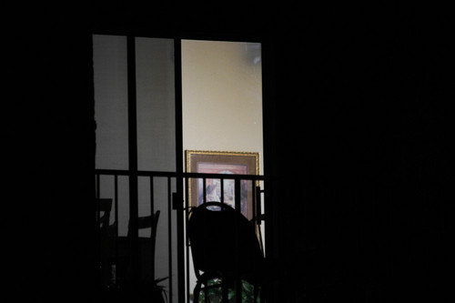 The nighttime view of a residential window in one of a series of photographs found on a memory card and alleged to have come from an FLDS church security team.