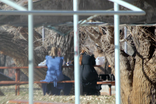 Four girls eat in Cottonwood Park in Colorado City, Arizona, in one of a series of photographs found on a memory card and alleged to have come from an FLDS church security team.
