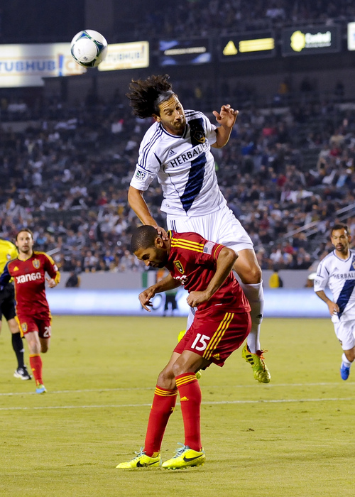 Los Angeles Galaxy defender Omar Gonzalez, top back, gets over Real Salt Lake forward Alvaro Saborio (15), of Costa Rica, will going for the ball during the first half of an MLS soccer match, Sunday, Nov. 3, 2013, in Carson, Calif. (AP Photo/Gus Ruelas)