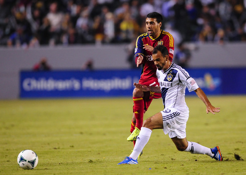 Real Salt Lake midfielder Javier Morales (11), of Argentina, and Los Angeles Galaxy midfielder Juninho, front right, of Brazil, collide as the battle for the ball during the first half of an MLS soccer match, Sunday, Nov. 3, 2013, in Carson, Calif. (AP Photo/Gus Ruelas)