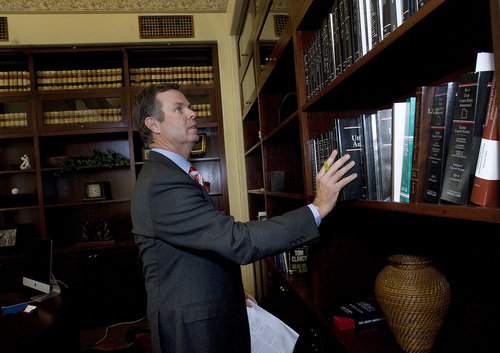Scott Sommerdorf   |  The Salt Lake Tribune Utah Attorney General John Swallow chooses from a group of law books in his office on the day it was announced the U.S. Department of Justice will not prosecute him, Thursday, September 12, 2013.