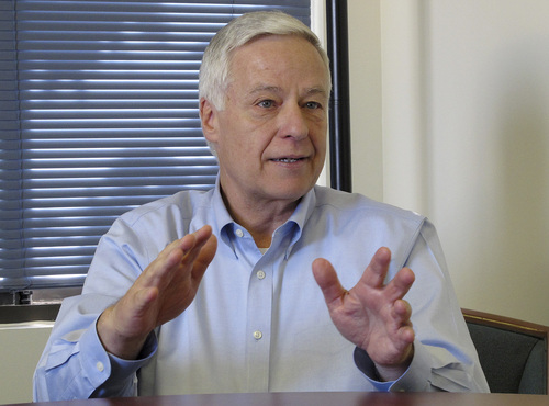 """U.S. Rep. Mike Michaud talks to an Associated Press reporter Monday, Nov. 4, 2013, in Portland, Maine, about his public announcement that he is gay. The Democrat is running for governor in 2014 in a three-way race challenging Republican incumbent Gov. Paul LePage and independent Eliot Cutler. Michaud said his announcement came in response to a """"whisper campaign"""" by political opponents hoping to weaken his campaign. (AP Photo/Clarke Canfield)"""