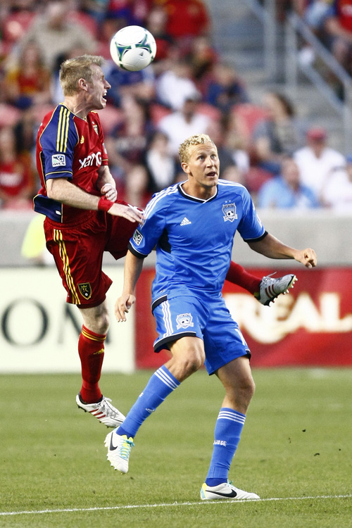 Chris Detrick  |  The Salt Lake Tribune Real Salt Lake defender Nat Borchers (6) and San Jose Earthquakes forward Steven Lenhart (16) go for the ball during the game at Rio Tinto Stadium Saturday September 21, 2013.  San Jose is winning the game 2-1 at halftime.