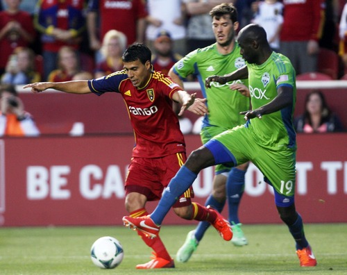 Kim Raff  |  The Salt Lake Tribune (left) Real Salt Lake midfielder Javier Morales (11) tries to dribble past (right) Seattle Sounders FC defender Djimi Traore (19) during the second half at Rio Tinto Stadium in Sandy on June 22, 2013. Real went on to win the game 2-0.