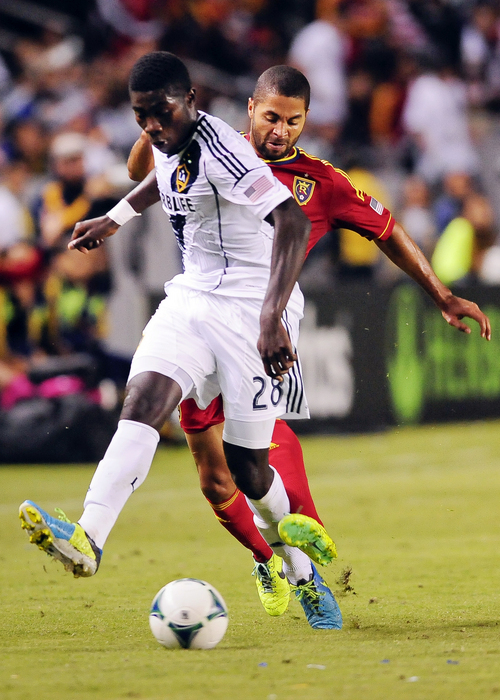 Real Salt Lake forward Alvaro Saborio, back right, of Costa Rica, attempts to steal the ball from Los Angeles Galaxy defender Kofi Opare (28), of Ghana, as Opare brings it up the field during the first half of an MLS soccer match Sunday, Nov. 3, 2013, in Carson, Calif. The Galaxy won 1-0. (AP Photo/Gus Ruelas)