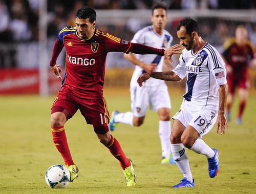 Real Salt Lake midfielder Javier Morales (11), of Argentina, gets by Los Angeles Galaxy midfielder Juninho (19), of Brazil, during the first half of an MLS soccer match, Sunday, Nov. 3, 2013, in Carson, Calif. (AP Photo/Gus Ruelas)