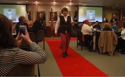 Rick Egan  | The Salt Lake Tribune   Brenda Joy Talford walks the run way during the Women Veterans Fatigues to Fabulous fashion show, Monday, November 4, 2013.