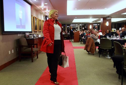 Rick Egan  | The Salt Lake Tribune   Jenna McMichael walks the run way during the Women Veterans Fatigues to Fabulous   fashion show, Monday, November 4, 2013.