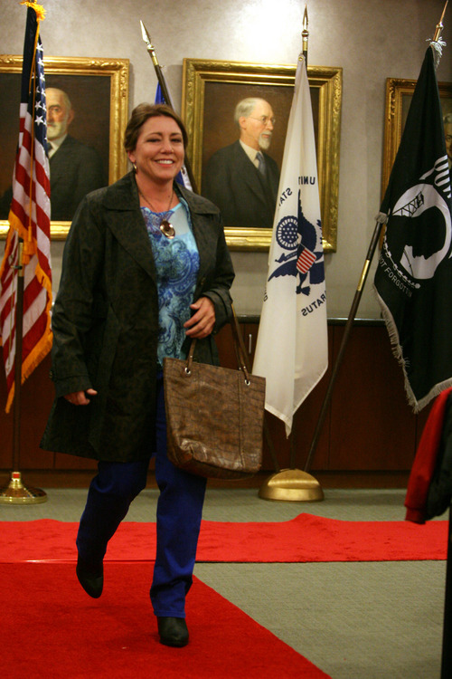 Rick Egan  | The Salt Lake Tribune   Darlene Bledsoe walks the run way during the Women Veterans Fatigues to Fabulous fashion show, Monday, November 4, 2013.