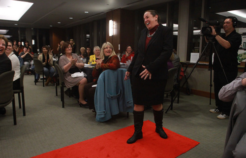 Rick Egan  | The Salt Lake Tribune   Kim Adamson poses on the run way during the Women Veterans Fatigues to Fabulous fashion show, Monday, November 4, 2013.