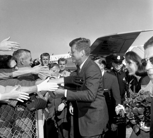 Hands reach out to greet President John F. Kennedy and first lady Jacqueline Kennedy upon their arrival at Dallas Love Field, Nov. 22, 1963. Later that day, the president was assassinated. (AP Photo)