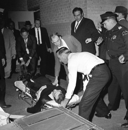 Lee Harvey Oswald, accussed assassin of President John F. Kennedy, is placed on a stretcher after being shot in the stomach in Dallas, Texas, Sunday, Nov. 24, 1963.  Nightclub owner Jack Ruby shot and killed Oswald as the prisoner was being transferred through the underground garage of Dallas police headquarters.  (AP Photo/David F. Smith)