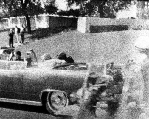 President John F. Kennedy slumps against his wife as the bullet from an assassin's rifle strikes him in the head in Dallas, Texas, Nov. 22, 1963.  Gov. John Connally of Texas, who was wounded in the attack, begins to turn around just to the left of Mrs. Kennedy. Picture by Mrs. Mary Ann Moorman, wife of a Dallas plumber, with a Polaroid camera. (AP Photo/Mary Ann Moorman) **NO SALES**