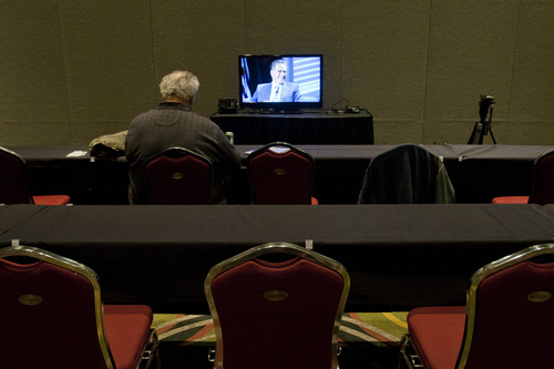 Chris Detrick  |  The Salt Lake Tribune Mitt Romney is shown on a TV in the media holding room during the TEAMS Conference & Expo at the Salt Palace Convention Center Tuesday November 5, 2013.