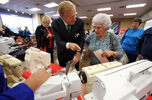 Francisco Kjolseth  |  The Salt Lake Tribune Hanspeter Ueltschi, a fourth generation owner of the Bernina Company, meets Magdalena Yost, 82, of Kamas as she shows off all the quilts she has made for Primary Children's Hospital on her Bernina 830 that she bought in 1977, before getting it signed. Ueltschi arrived in Utah to celebrate the state's love of all things sewing machines at a new Nuttall's store in Riverton on Monday, Nov. 4, 2013. Many fans of the sewing machines brought in their own to get them signed.