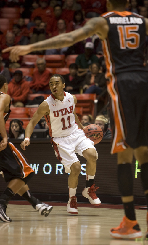 Kim Raff  |  The Salt Lake Tribune Utah Utes guard Brandon Taylor (11) looks to pass the ball during a game against Oregon State at the Huntsman Center in Salt Lake City on March 7, 2013. Utah went on to win 72-61.