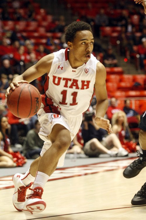 Ashley Detrick  |  The Salt Lake Tribune Utah Utes guard Brandon Taylor (11) drives to the basket during the game against Stanford at Utah Sunday January 27, 2013. Utes were trailing the Cardinals at half, 46-26. Stanford won, 87-56.