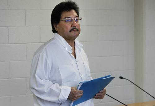 Scott Sommerdorf   |  The Salt Lake Tribune Michael Doporto picks up his papers after the Utah Board of Pardons victim impact hearing, Thursday, October 10, 2013.