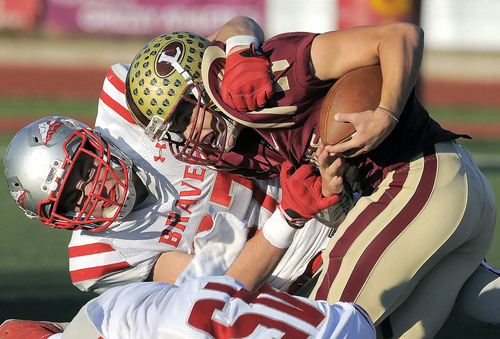 Bountiful's Mitchell Halverson tackles Logan's Chase Nelson, Friday, Nov. 1  in Logan. (Eli Lucero/Herald Journal)