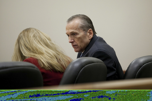 Mark Johnston  |  Pool Martin MacNeill speaks to his attorney Susanne Gustin, left, during his trial at 4th District Court in Provo Tuesday, Nov. 5, 2013. MacNeill is charged with murder for allegedly killing his wife Michele MacNeill in 2007.