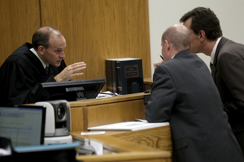Mark Johnston  |  Pool Judge Derek Pullan, left, holds a bench conference with prosecutor Chad Grunander and defense attorney Randy Spencer during the trial of Martin MacNeill at 4th District Court in Provo Tuesday, Nov. 5, 2013. MacNeill is charged with murder for allegedly killing his wife Michele MacNeill in 2007.