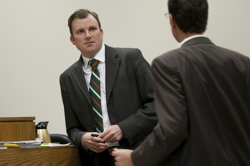 Mark Johnston  |  Pool Prosecutor Jared Perkins, left, waits for defense attorney Randy Spencer, right, before discussing matters with Judge Derek Pullan during the trial of Martin MacNeill at 4th District Court in Provo Tuesday, Nov. 5, 2013. MacNeill is charged with murder for allegedly killing his wife Michele MacNeill in 2007.