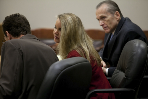 Mark Johnston  |  Pool Attorney Susanne Gustin, center, speaks to attorney Randy Spencer, left, as their client Martin MacNeill listens in during MacNeill's trial at 4th District Court in Provo Tuesday, Nov. 5, 2013. MacNeill is charged with murder for allegedly killing his wife Michele MacNeill in 2007.