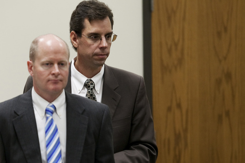 Mark Johnston  |  Pool Prosecutor Chad Grunander, left, and defense attorney Randy Spencer return to their seats during the trial of Martin MacNeill at 4th District Court in Provo Tuesday, Nov. 5, 2013. MacNeill is charged with murder for allegedly killing his wife Michele MacNeill in 2007.