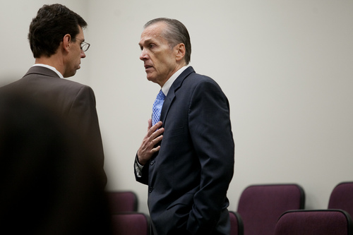 Martin MacNeill speaks to his attorney Randy Spencer, left, before proceedings at the Fourth District Court in Provo Tuesday, Nov. 5, 2013. MacNeill is charged with murder for allegedly killing his wife Michele MacNeill in 2007.  MARK JOHNSTON/Daily Herald