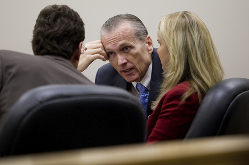 Martin MacNeill speaks to his attorneys Susanne Gustin, right, and Randy Spencer during his trial at the Fourth District Court in Provo Tuesday, Nov. 5, 2013. MacNeill is charged with murder for allegedly killing his wife Michele MacNeill in 2007.  MARK JOHNSTON/Daily Herald