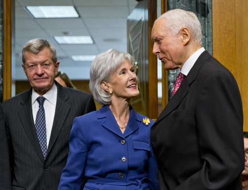 Health and Human Services Secretary Kathleen Sebelius, center, is greeted by Sen. Orrin Hatch, R-Utah, ranking Republican on the Senate Finance Committee, right, as she is escorted by the committee's Chairman Sen. Max Baucus, D-Mont., on Capitol Hill in Washington, Wednesday, Nov. 6, 2013, prior to testifying before the committee's hearing on the difficulties plaguing the implementation of the Affordable Care Act. The massive failure at healthcare.gov website is getting new criticism for lack of proper cybersecurity protections.  (AP Photo/J. Scott Applewhite)
