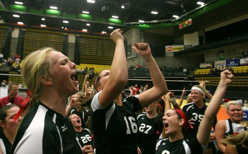 Rick Egan    The Salt Lake Tribune   Hurricane High celebrates their 3A volley ball State Championship title over Desert Hills, Saturday, November 2, 2013.
