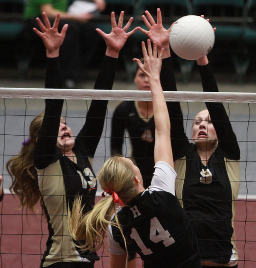 Rick Egan    The Salt Lake Tribune   Hurricaine's Kyndall Gardner (14) hits the ball, as Courtney Sheeran (13) and Aubrey Farrer (9) defend for Desert Hill's in the 3A volleyball State Championship game, Saturday, November 2, 2013.