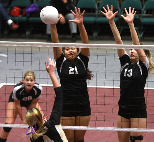 Rick Egan    The Salt Lake Tribune   Desert Hill's Blair Bliss (4) knocks the ball over the net, as Sela Filo (21) and Malary Reid (13) defend for Hurricane, in the 3A volleyball State Championship game, Saturday, November 2, 2013.
