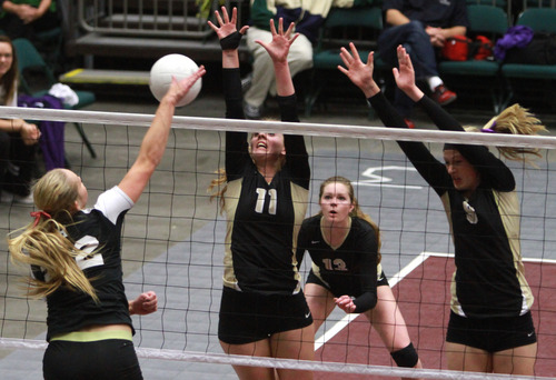 Rick Egan    The Salt Lake Tribune   Desert Hill's Alexa Goulding (11) and Aubrey Farrer defend as Brooklyn Gubler (32) hits the ball for Hurricane, in the 3A volleyball State Championship game, Saturday, November 2, 2013.