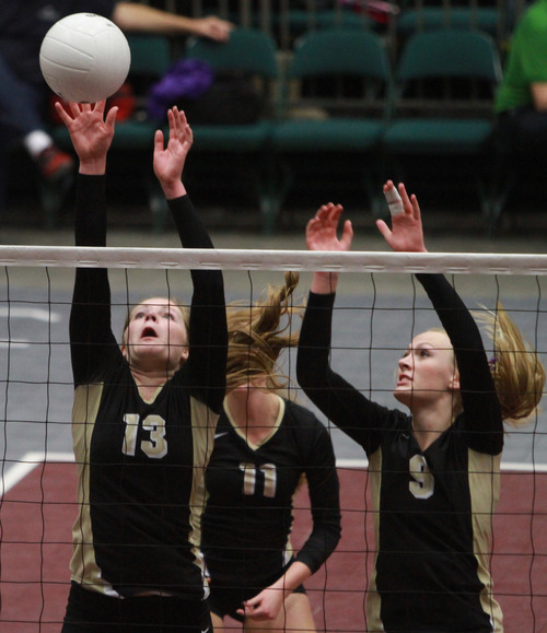Rick Egan    The Salt Lake Tribune   Desert Hill's Courtney Sheeran (13) and Aubrey Farrer (9) block a shot by Hurricane in the 3A volley ball State Championship game,  Saturday, November 2, 2013.