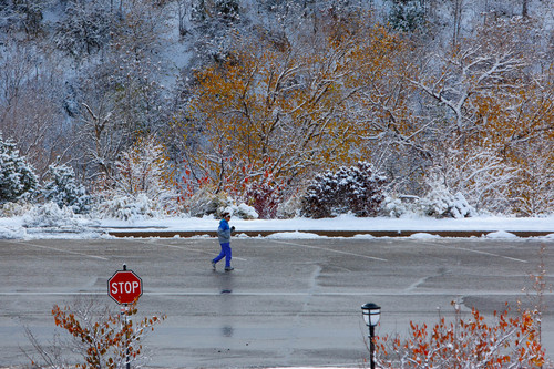 Trent Nelson  |  The Salt Lake Tribune A woman jogs in a snow-filled scene Tuesday Nov. 5, 2013, near the Capitol building in Salt Lake City. Utah's water year got off to a good start in October with soil moisture at 58 percent across Utah, up from 42 percent in October 2012.