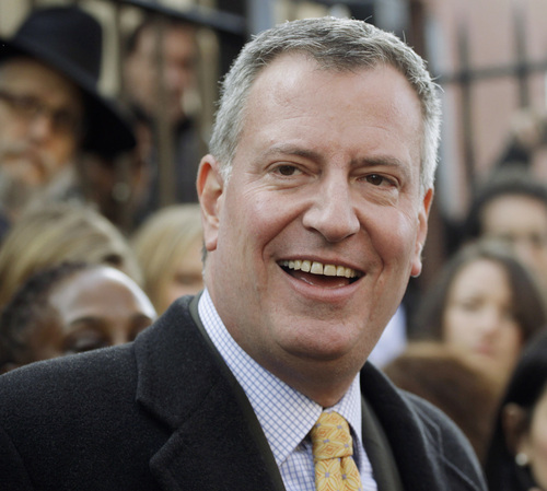 FILE- In this Nov. 5, 2013, file photo, Democratic mayoral candidate Bill de Blasio, talks to the media after voting in the Park Slope neighborhood in the Brooklyn borough of New York. De Blasio has won the race for the New York City Mayor's Office, beating Republican Joe Lhota. (AP Photo/Mark Lennihan, File)