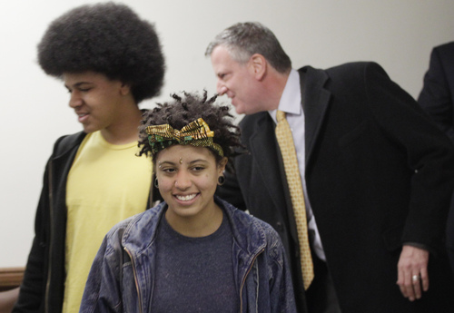 Democratic mayoral candidate Bill de Blasio, right, arrives at a polling station with his son Dante, left, and daughter Chiara, Tuesday, Nov. 5, 2013 in the Park Slope neighborhood of the Brooklyn borough of New York. De Blasio is running against Republican candidate Joseph Lhota. (AP Photo/Mark Lennihan)