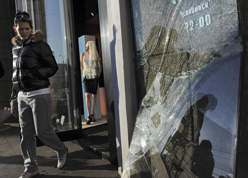 Boris Kaulin | Associated Press A woman leaves a shop with a broken window in Chelyabinsk, Russia, on Monday, Feb. 18, 2013,  as part of the local damage after a meteorite exploded over the region on Feb. 15.  A total of 53 pieces of space debris have been brought for analysis to the university in Yekaterinburg, with the largest being about one centimeter in diameter, and the smallest is about one millimeter. New research suggests such asteroids may be more common than previously believed.