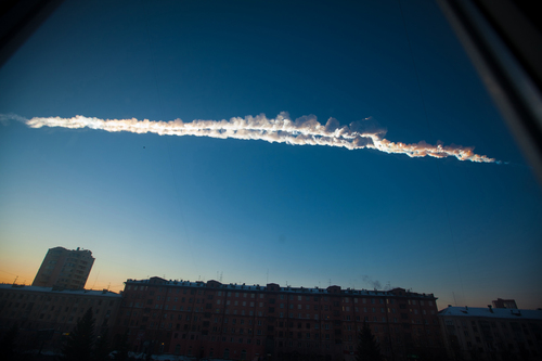 FILE - In this Feb. 15, 2013 file photo provided by Chelyabinsk.ru, shows a meteorite contrail over the Ural Mountains' city of Chelyabinsk, about 930 miles east of Moscow, Russia. After a surprise meteor hit Earth at 42,000 mph and exploded over a Russian city in February, smashing windows and causing minor injuries, scientists studying the aftermath say the threat of space rocks hurtling toward our planet is bigger than they had thought. Meteors like the one that exploded over Chelyabinsk _ and those that are even bigger and more dangerous _ are probably four to five times more likely to hit Earth than scientists thought before the February mid-air explosion, according to three studies released Wednesday in the journals Nature and Science.  (AP Photo/Chelyabinsk.ru, Yekaterina Pustynnikova, File)