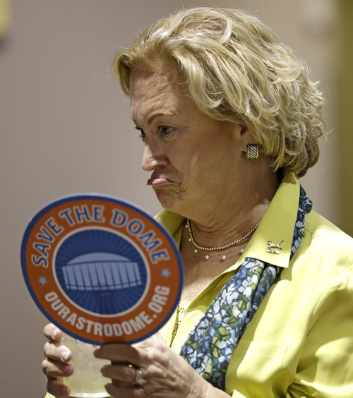 """Sally Allen makes a face as she waits with others during a """"Save the Dome"""" election results party Tuesday, Nov. 5, 2013, in Houston. Houston-area voters are deciding whether to convert the Astrodome into a convention center or allow the iconic stadium to be demolished. (AP Photo/David J. Phillip)"""