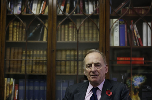 Julian Radcliffe, chairman of the Art Loss Register poses for the photographer during an interview in central London, Wednesday, Nov. 6, 2013. Phones in these London offices have been ringing off the hook since the announcement that German authorities have discovered more than 1,400 artworks, some by modern masters such as Marc Chagall, Henri Matisse and Pablo Picasso, stacked in a Munich apartment. German officials have not revealed details about the vast majority of the paintings, drawings, engravings, woodcuts and prints they have found, sparking a scramble for information on the part of art-hunters and lawyers for those seeking to recover looted art. (AP Photo/Lefteris Pitarakis)