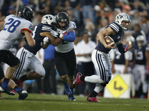 Scott Sommerdorf   |  The Salt Lake Tribune BYU QB Taysom Hill runs for a 20 yard TD to gibe BYU and 7-0 lead. BYU held a 24-3 lead over Boise State, Friday, October 25, 2013